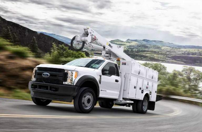 White 2018 Ford Super Duty Chassis Cab Driving up a Mountain Road