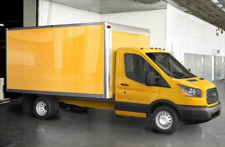 Yellow 2018 Ford Transit Chassis Cab Parked by a Loading Dock in a Warehouse