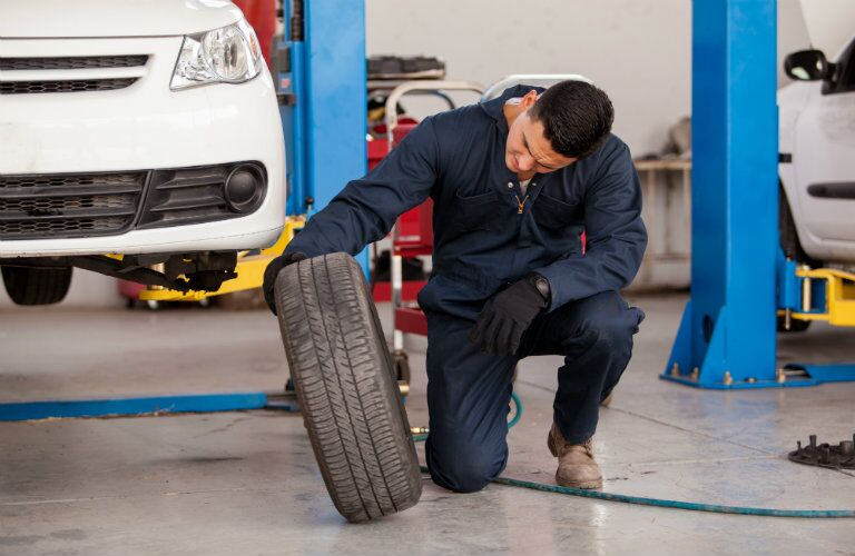 Mechanic looking at a tire