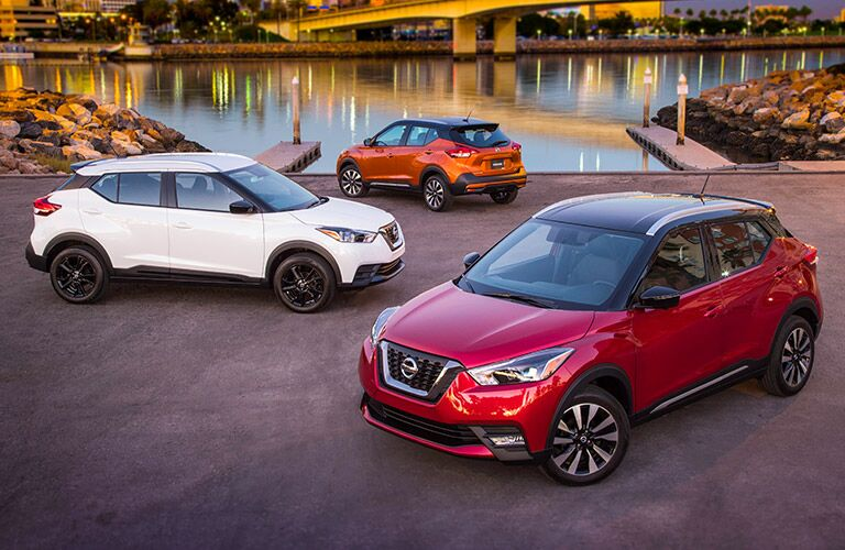 three 2018 Nissan Kicks crossovers in different colors