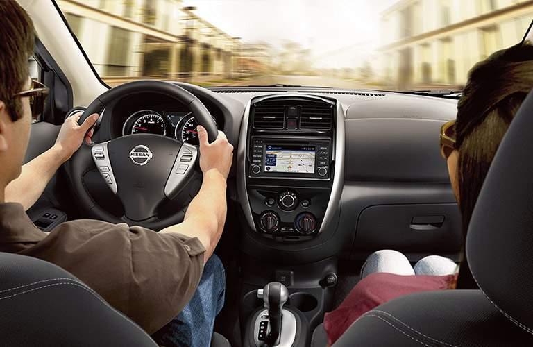 2018 Nissan Versa Sedan interior with driver and passenger