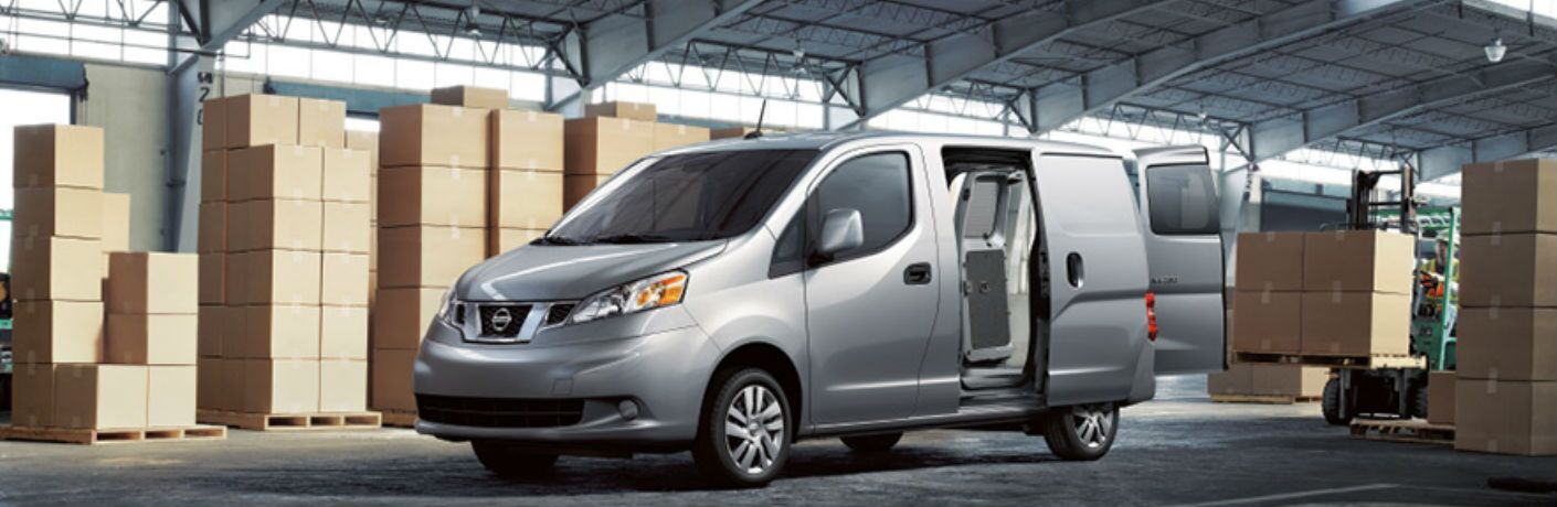 2018 Nissan NV200 Compact Cargo Van in warehouse with side door open