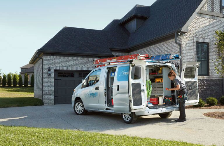 2018 Nissan NV200 Compact Cargo Van parked in driveway