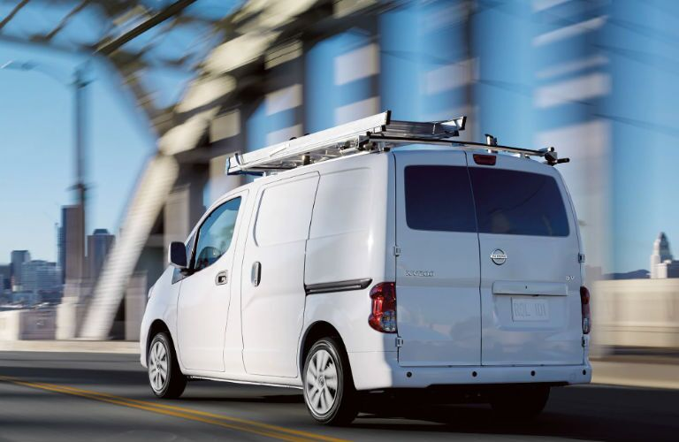 2019 Nissan NV200 Compact Cargo Van driving on a road