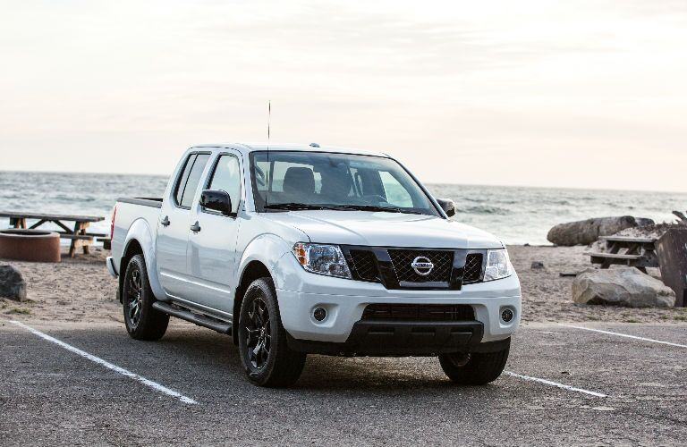 2019 Nissan Frontier parked by a beach