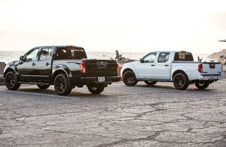 Two 2019 Nissan Frontier models parked next to each other