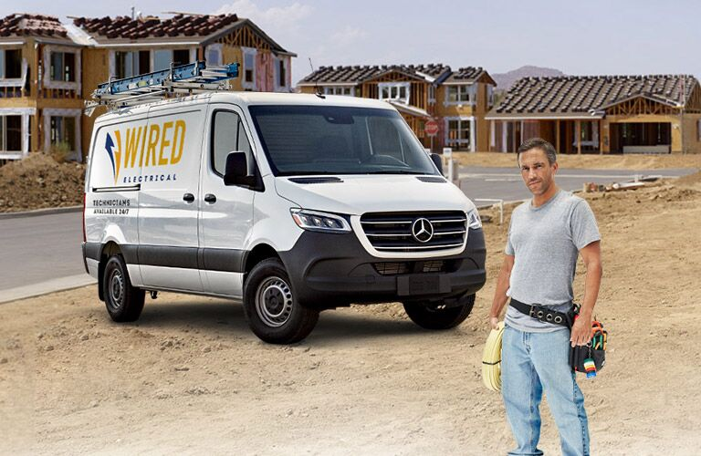 Mercedes-Benz Sprinter exterior profile with man posing in front