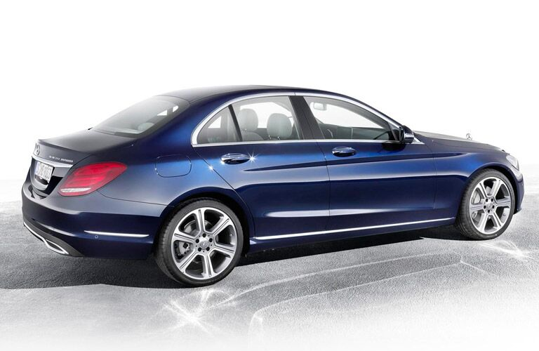 side view of a blue 2014 Mercedes-Benz C-Class