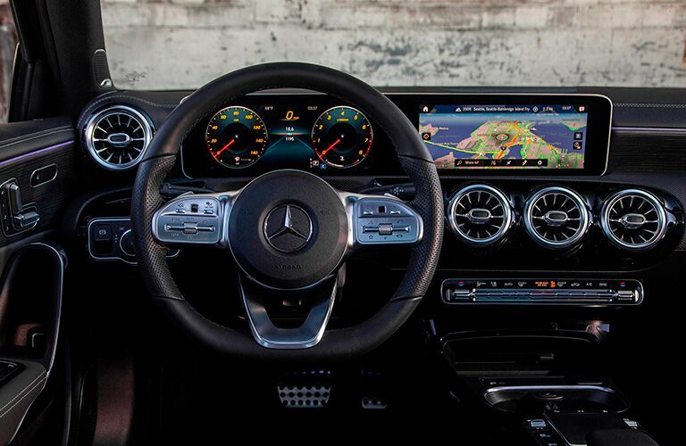 A photo of the driver's cockpit in the 2021 Mercedes-Benz A-Class Sedan.