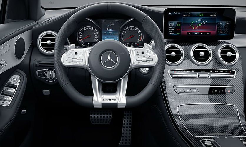 A photo of the driver's cockpit in in the 2021 Mercedes-AMG® GLC 43 SUV.