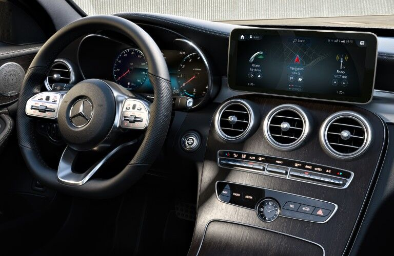 A photo of the driver's cockpit in the 2021 Mercedes-Benz C 300 4MATIC®.