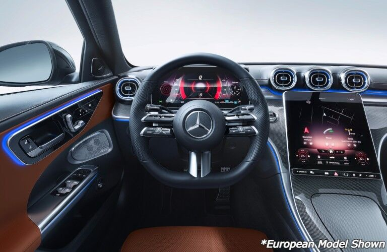 A photo of the driver's cockpit in the 2022 Mercedes-Benz C-Class Sedan.