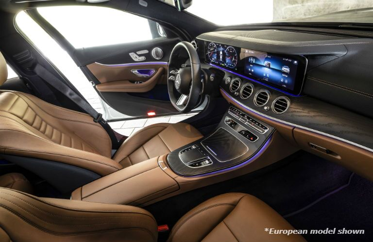 A photo of the front seats and dashboard in the 2021 Mercedes-Benz E 350 4MATIC® in Indianapolis, IN.