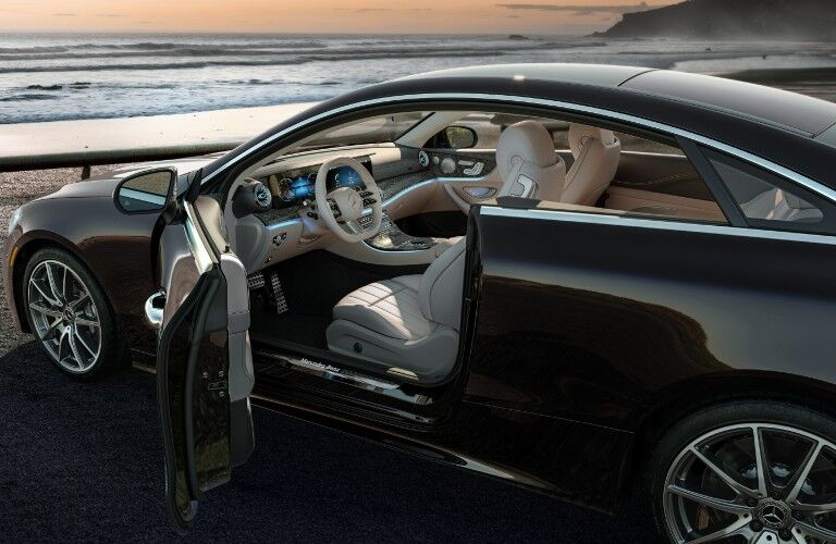 A photo of the driver's cockpit viewed from the outside of the 2021 Mercedes-Benz E-Class Coupe.