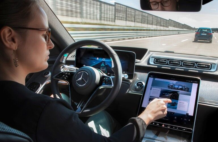 A photo of a person using the technology in the 2021 Mercedes-Benz S 580 4MATIC® Sedan.