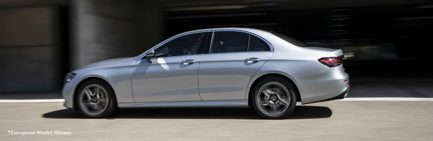 A left profile photo of the 2021 Mercedes-Benz E 350 on the road.