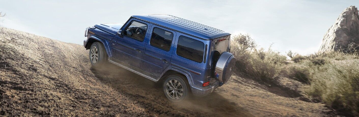The photo of the 2021 Mercedes-Benz G 550 climbing a hill.