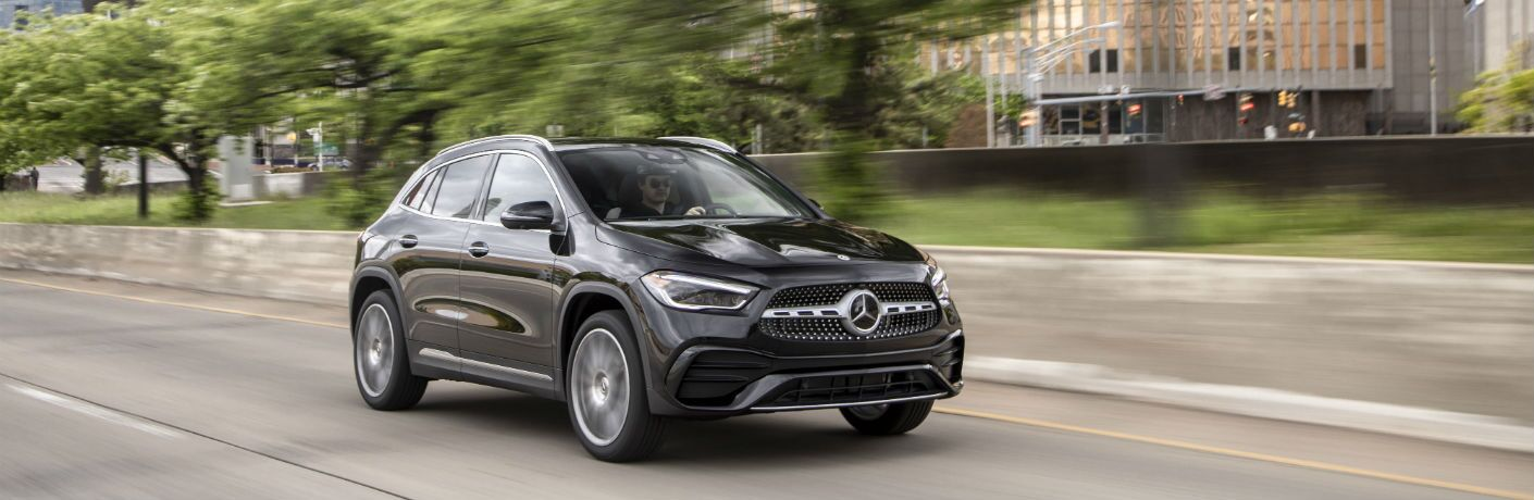 A front right quarter photo of the 2021 Mercdes-Benz GLA 250 4MATIC® on the road.