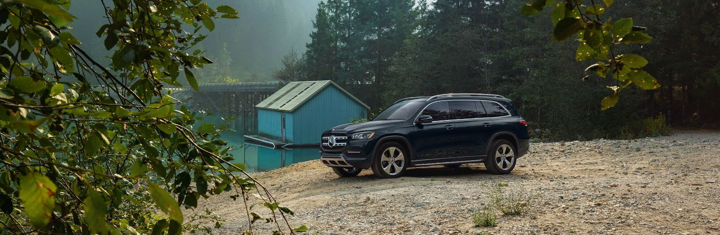 A photo of the 2021 Mercedes-Benz GLS 450 4MATIC® parked in the woods.