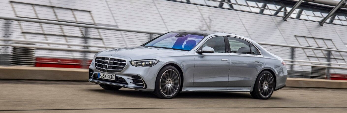 A left profile photo of the 2021 Mercedes-Benz S 500 4MATIC® Sedan on a race track.