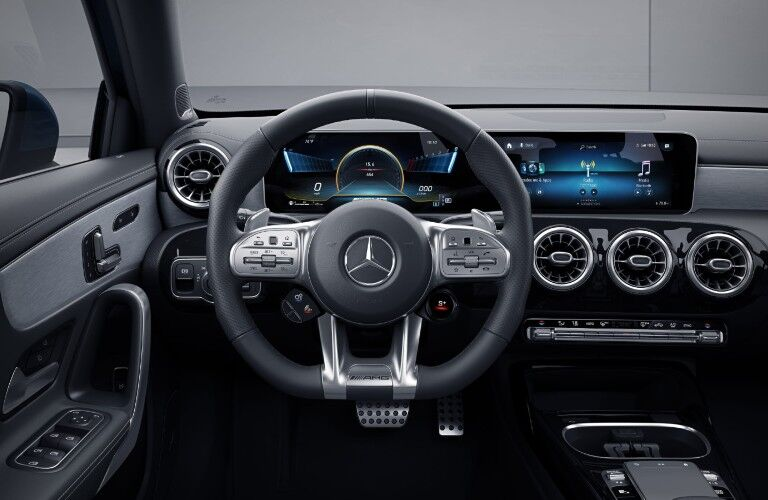 A photo of the driver's cockpit in the 2021 Mercedes-AMG® A 35 Sedan.