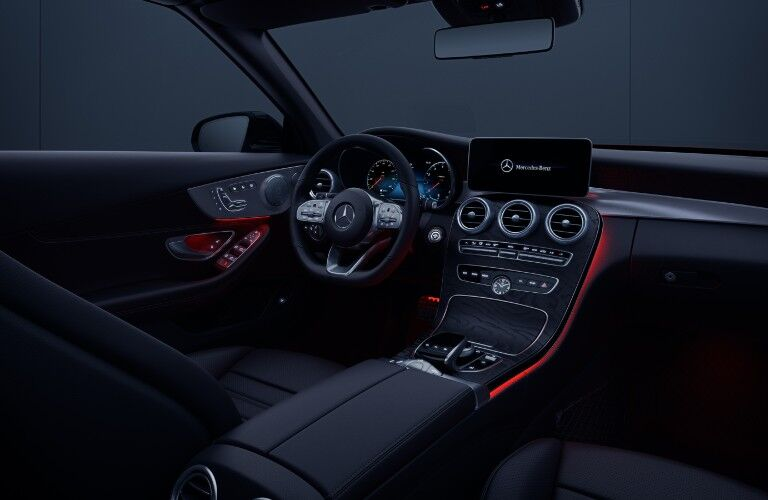 A passenger-side view of the driver's cockpit in the 2021 Mercedes-Benz C-Class Cabriolet.