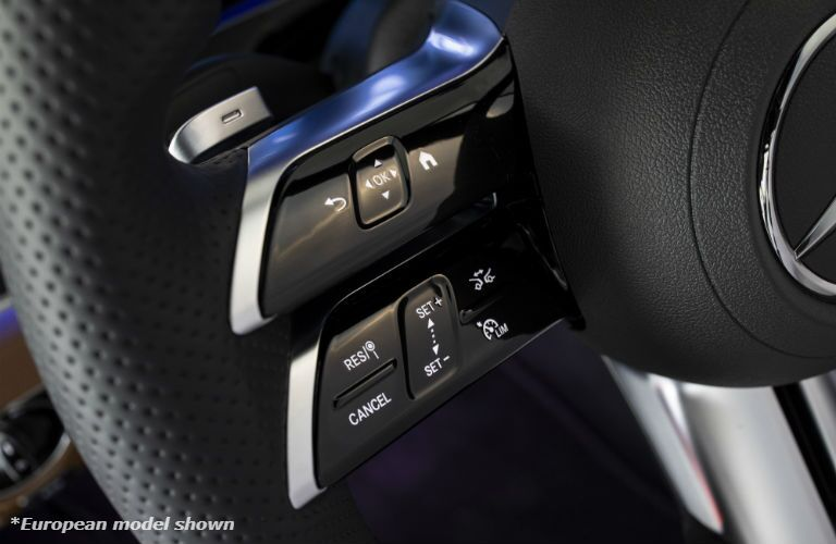 A photo of the left-side steering wheel controls in the 2021 Mercedes-Benz 3 350 4MATIC® in Indianapolis, IN.