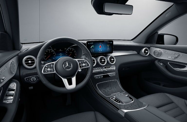 A photo of the dashboard and driver's cockpit in the 2021 Mercedes-Benz GLC SUV.