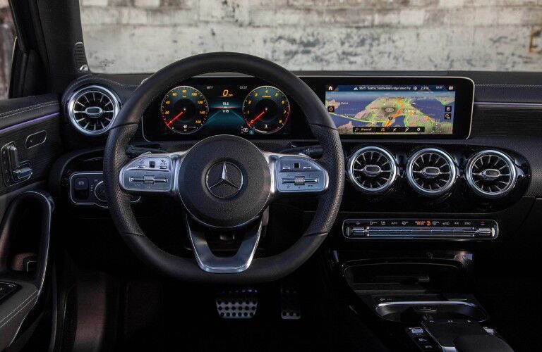 A photo of the driver's cockpit in the 2021 Mercedes-Benz A 220 Sedan.