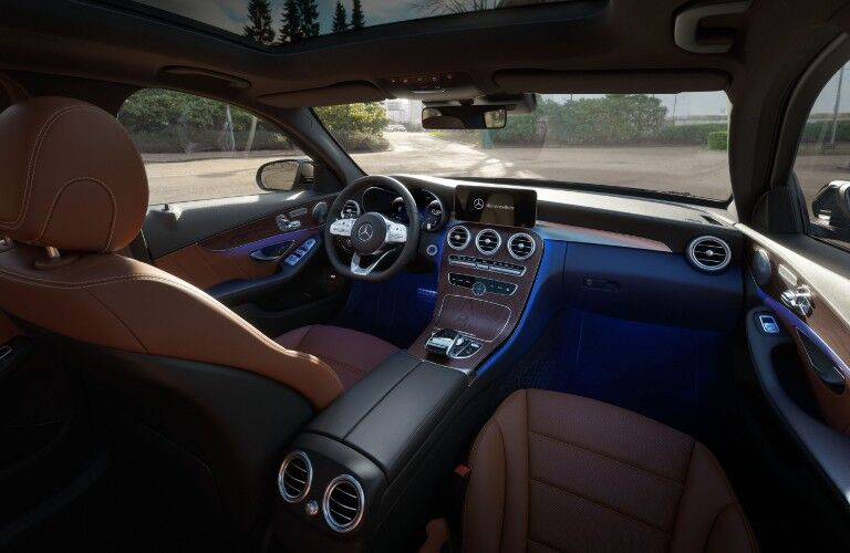 A photo of the dashboard and front seats in the 2021 Mercedes-Benz C 300 Sedan.
