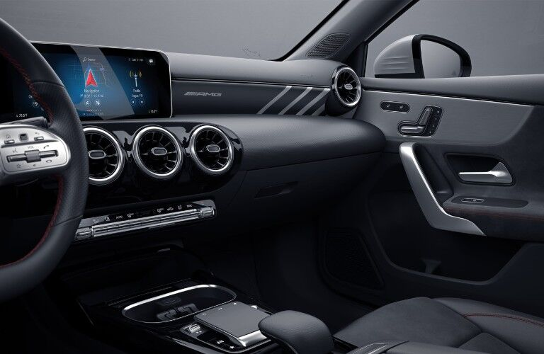 A photo of the touchscreen and dashboard in the 2021 Mercedes-AMG® A 35 Sedan.