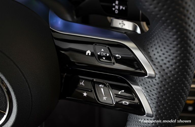 A photo of the right-side steering controls in the 2021 Mercedes-Benz 3 350 4MATIC® in Indianapolis, IN