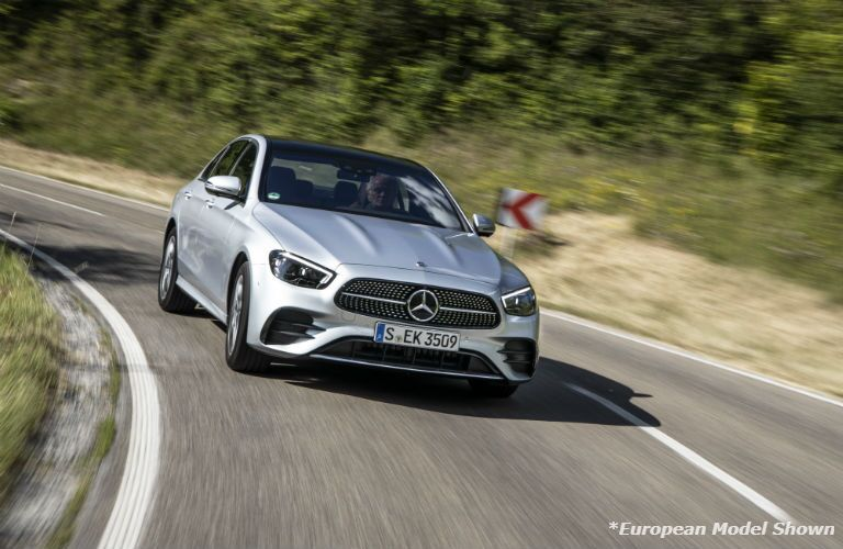 A head-on photo of the 2021 Mercedes-Benz E 350 in motion on the road.