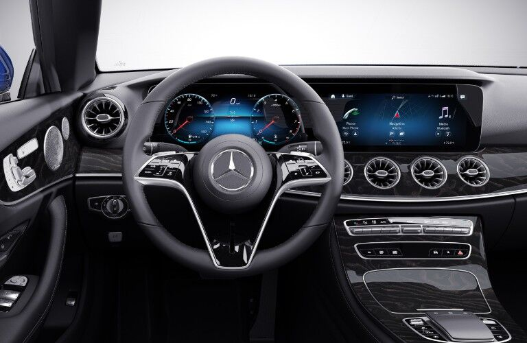 An inside view of the driver's cockpit in the 2021 Mercedes-Benz E-Class Coupe.