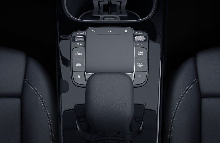 The lower console of the 2021 CLA 250 Coupe featuring the gear-shifter and infotainment system touchpad.