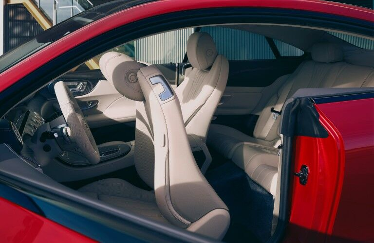 A photo of the front and back seats in the 2021 Mercedes-Benz E-Class Coupe.