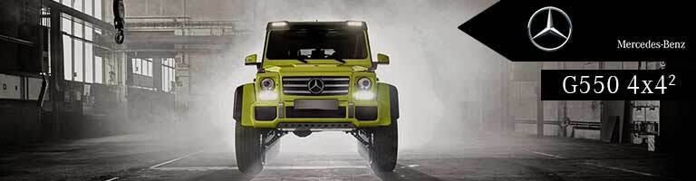 yellow 2018 Mercedes-Benz G 550 in a warehouse with banner in top right corner