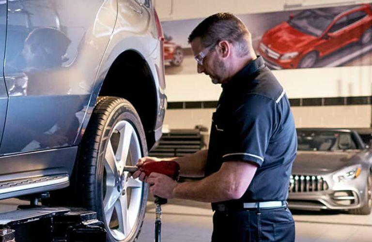 Mercedes-Benz technician servicing a Mercedes-Benz