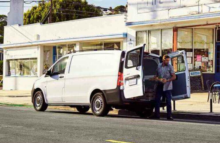 Man loading cargo into the 2017 Mercedes-Benz Metris Cargo Van