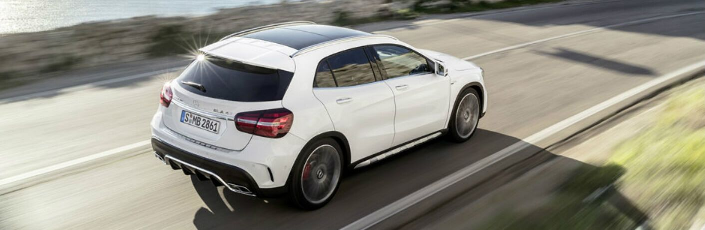 White 2018 Mercedes-Benz GLA driving cliffside