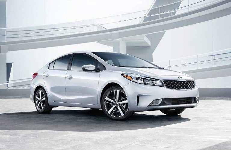 right side view of a white 2018 Kia Forte