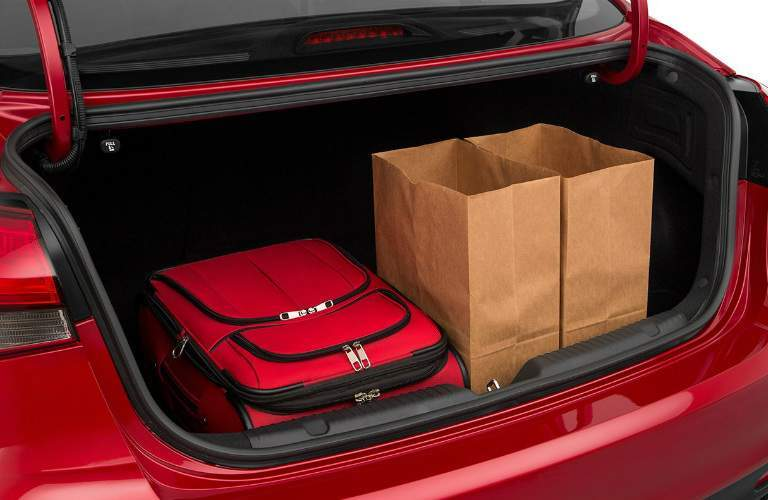groceries and luggage in the back of a 2018 Kia Forte