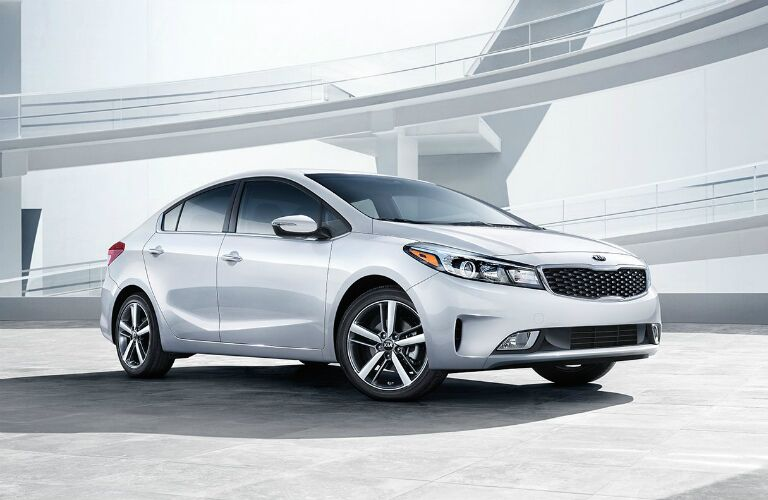 White 2018 Kia Forte parked by ramps