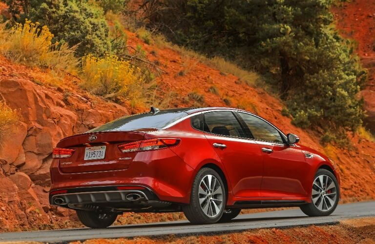 Right side rear view of a red 2018 Kia Optima