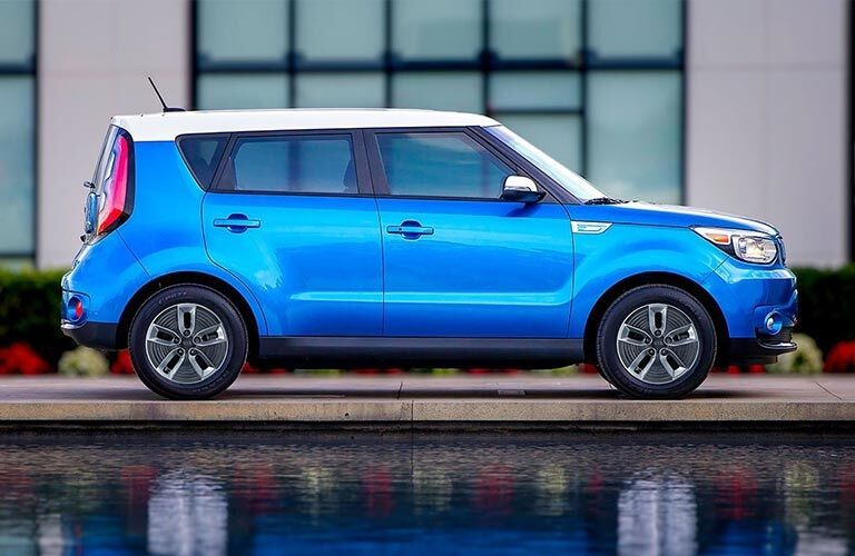 Side view of a blue and white 2018 Kia Soul EV