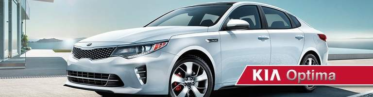 "white Kia Optima behind ""Kia Optima"" text"