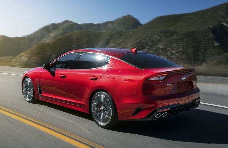 2019 Kia Stinger driving by mountains
