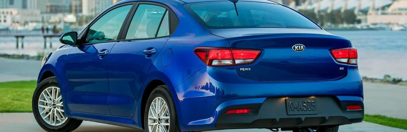 Rear view look at a blue 2018 Kia Rio EX