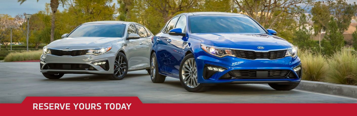 Two 2019 Kia Optima models side by side with Reserve Yours Today text