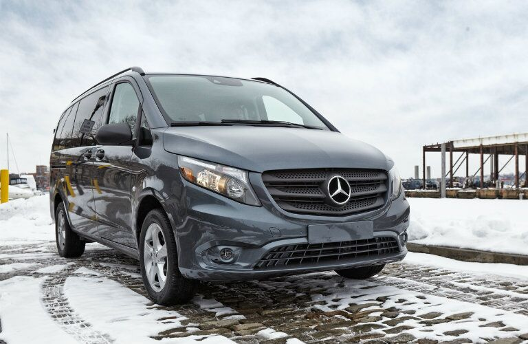 front and side view of a 2016 Mercedes-Benz Metris Passenger Van in the snow